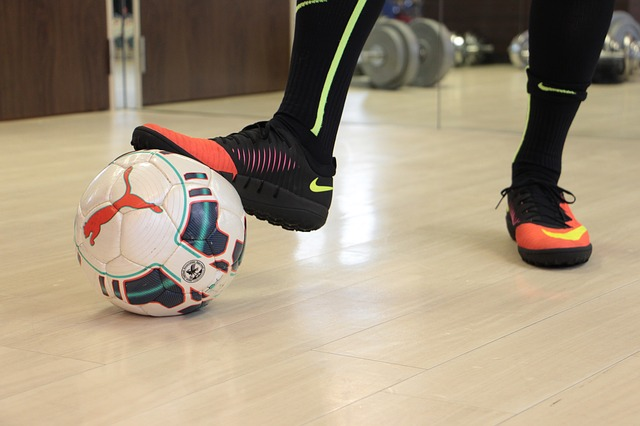 Foot resting on soccer ball